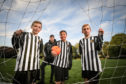 Ethan McWilliam, Alfie Stott and Kai McLellen with Chairman of Newtyle United, John Robertson and the damaged nets.