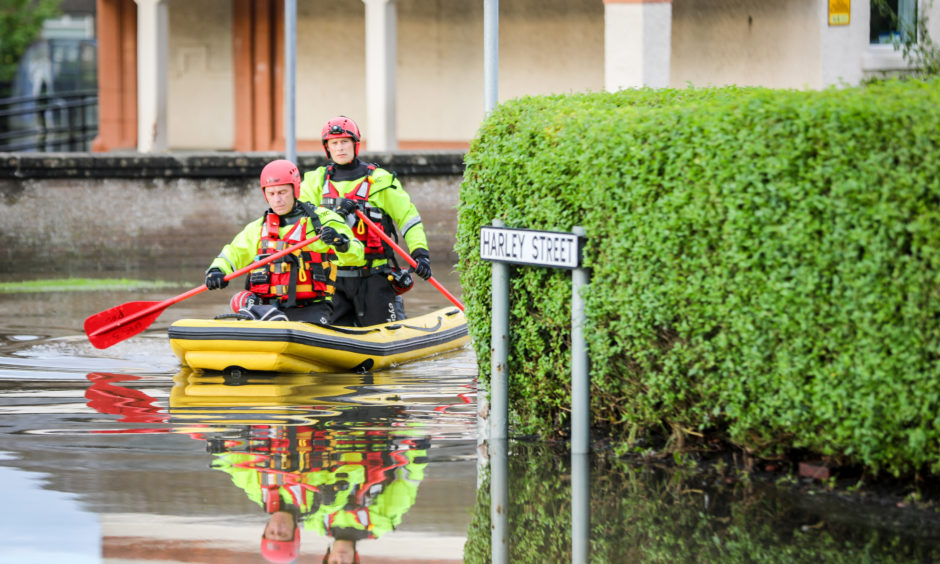Residents had to be evacuated from houses in the Park Road area of Rosyth after intense rain fall saw houses flooded. Pic shows; flooding in the area with Scottish Fire and Rescue rescuing residents, retrieving medication and pets with inflatable boats. Picture by Kris Miller / DCT Media