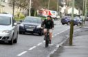 Councillor Kevin Cordell cycling in Dundee.