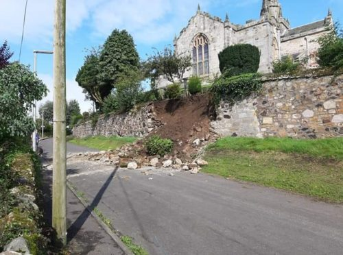 Graveyard wall collapsed after heavy rain.
