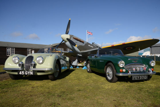 Richard Burton's Jaguar XK120 and an Austin Healey 3000 alongside the Red Lichtie replica Spitfire at Montrose.