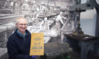 Gavin Grant at Kirkcaldy Art Gallery/Museum with an archive sample book.