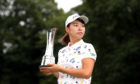 Japan's Hinako Shibuno lifts the trophy for the AIG Women's British Open during day four of the AIG Women's British Open at Woburn Golf Club, Little Brickhill.