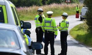 Police on the A97 near Kildrummy following the crash.