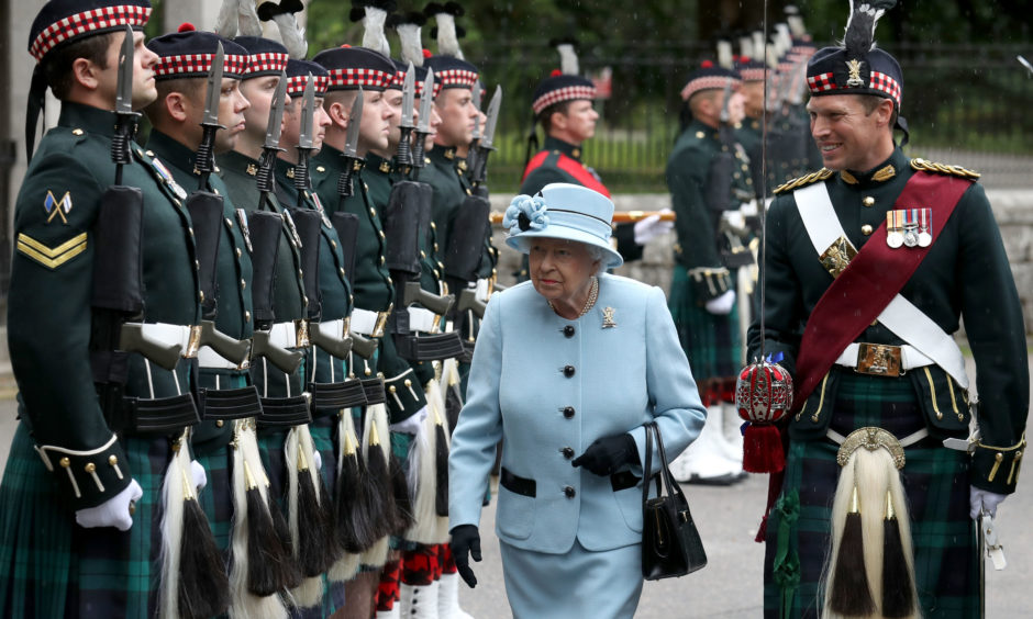 Queen Elizabeth II inspects the Balaklava Company, 5 Battalion The Royal Regiment of Scotland at the gates at Balmoral, as she takes up summer residence at the castle. The Queen met Regimental mascot Cpl Cruachan IV, as well as Pony Major Mark Wilkinson with music by the Pipes and drums 4th Battalion Royal Regiment of Scotland(4SCOTS).
