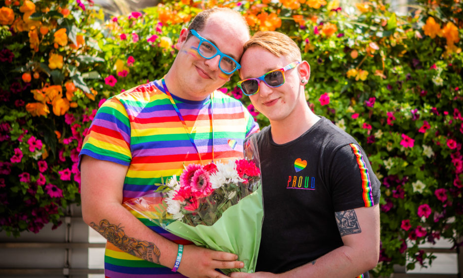 Danny Mitchell (left) proposed to Josh Ogilvie at the event.