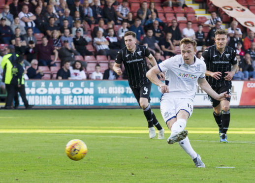 Dundee's Danny Johnson scores from the spot.
