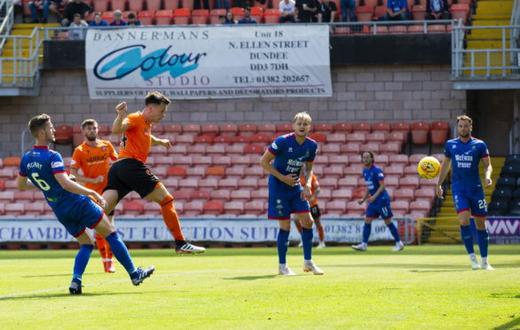 Dundee United's Lawrence Shankland scores the opener.