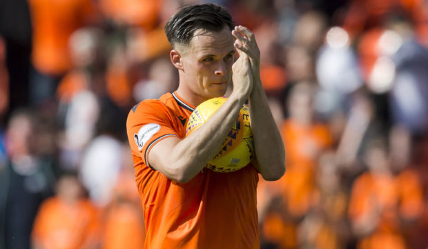 Lawrence Shankland with the match ball at the final whistle.
