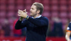 Robbie Neilson applauds the United fans at Firhill.