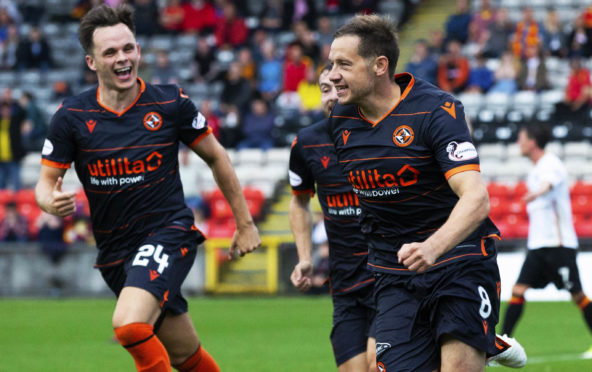 Lawrence Shankland helps Peter Pawlett celebrate his goal.