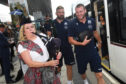 Scotland's John Barclay and Finn Russell arrive via tram at Edinburgh Airport on their way to Nice.