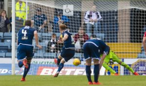 Danny Johnson scores from the spot for Dundee.