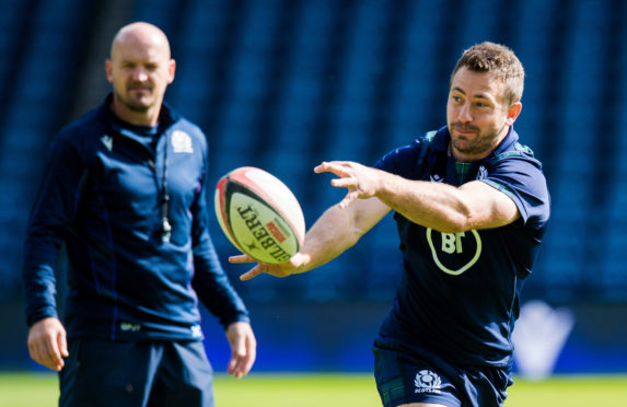 Greig Laidlaw leads the captain's run at Murrayfield under the watchful eye of head coach Gregor Townsend.