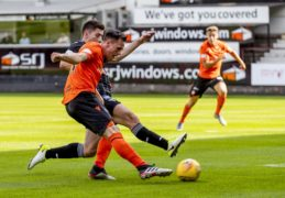 Lawrence Shankland fires in his first goal.