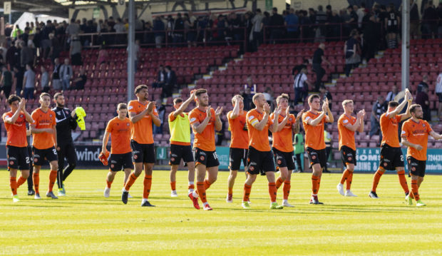 The United players applaud their fans after the win at Dunfermline.