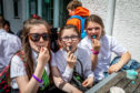Lucy Renton (11), Amy Macaskill (12) and Niomi Smith (12) loving their ice cream at Jannettas in St Andrews.