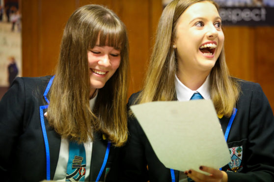 Minnie Brocklesby and Charlie Stewart from Woodmill High, Dunfermline, are overjoyed