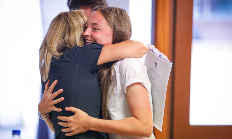 More than 136,000 candidates who have completed SQA exams, courses and awards this year received their results on Tuesday. Robyn McCafferty, at Woodmill High School, Dunfermline gets a congratulatory hug from her mum after receiving her results. Picture by Steve Brown / DCT Media