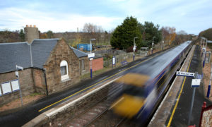 A train passes through Barry Links railway station near Carnoustie.