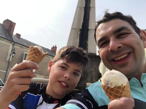 Reuben and Shaun take a break on the longest day of their epic bike ride through France.