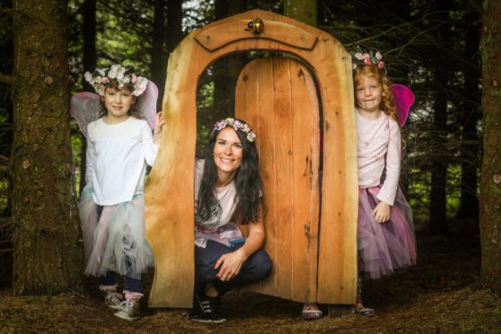 Gayle and her cute little fairy friends enjoy Brechin Castle's Fairy Trail.