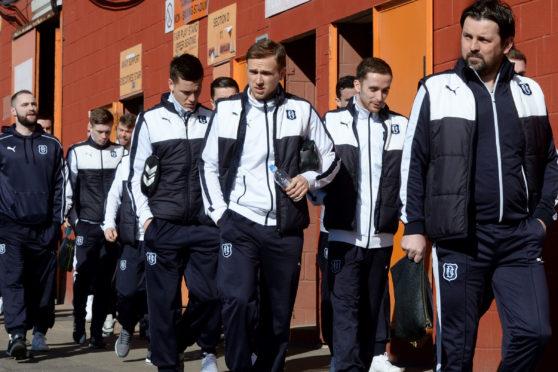 Paul Hartley and his team make the short walk to Tannadice.