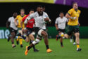 Waisea Nayacalevu runs in his side's second try during the Rugby World Cup match with Australia.