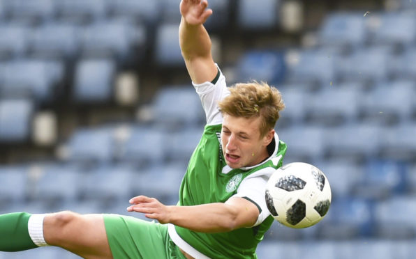 Sean Mackie in action for Hibs.