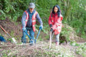 Ramsay Mudie of the Kirrie Den Project and Gayle Ritchie tidy up an embankment.