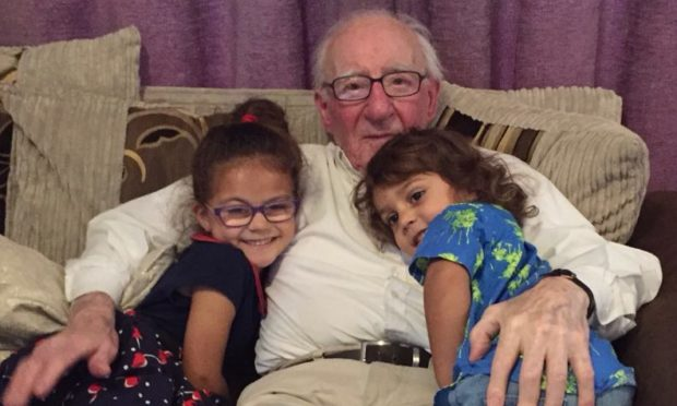 William Dye, known as Bill, with his two youngest grandchildren Laila and Kalibo