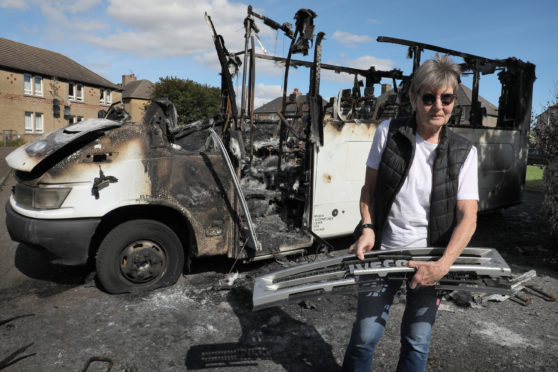 MyBUS director Mary Parry with the burnt out minibus.