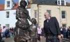 Sculptor Alan Herriot admires the memorial.