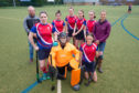 Members of Madras FP Hockey Club and parents, from left Neil Miller, Jade Milne, Louisa Miller, Mandy Bateman, Isla Bell, Rosie Bell, Grace Holden, Amy McClymont and Helen Holden.