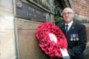 Wreaths were laid for Pte John Ferguson, including by RAF Sergeant John Flynn (pictured).