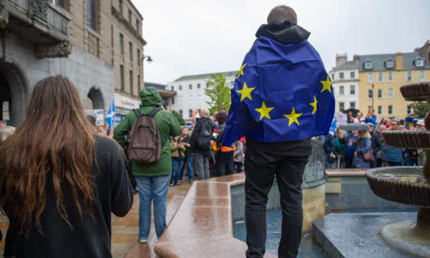 A protester wrapped in a Brexit flag outside Dundee City Chambers.