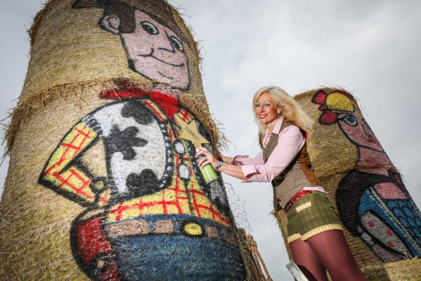 Fleur Baxter with her latest straw bale creations.