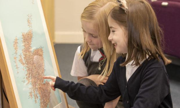 Pupils from RDM Primary School get acquainted with the map.