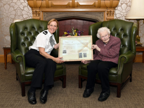 ACC Angela McLaren presented Minnie Clark with her police record.
