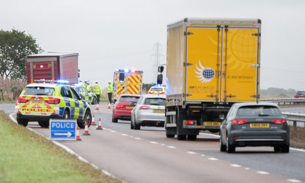 Man, 24, dies following crash between lorry and car on A90