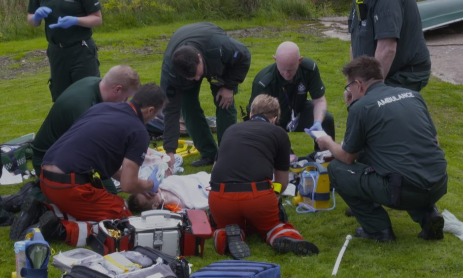 Paramedics working on little Felix after he was pulled from a loch