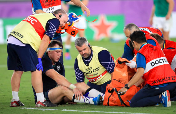 Scotland's Hamish Watson receives medical attention during the 2019 Rugby World Cup Pool A match.