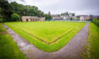 The disused bowling green is set to be converted into a beach volleyball court.