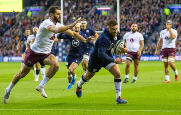 Ali Price goes in for Scotland's opening try against Georgia.