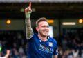 Dundee's Jordan McGhee celebrates his goal.