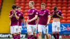 The Arbroath players look dejected at full-time at Tannadice.