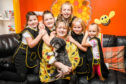 Catherine Sala-Murray of Kats Mission in Kinglassie with her Bizzy Bee helpers Katelyn Peggie,5,, Caitlyn Chi Waterston,10, Kali Campbell,9, Hallie Ferguson,11, and Maddie Ferguson,9.