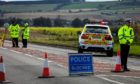 Police at the scene of the crash on the A92 near Ladybank.