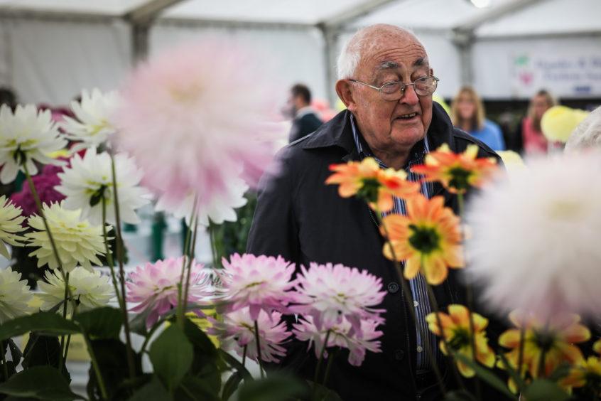 Ian Strachan admires the flowers.