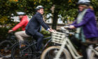 During the PATH Way to Work event, people from Perth had the chance to try out e-bikes and the group are calling for better infrastructure to encourage more people to make the change from travelling by car.